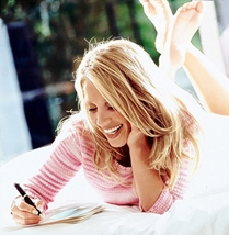 Happy woman writing